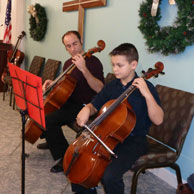 Grandson Craig playing cello with Uncle Tony