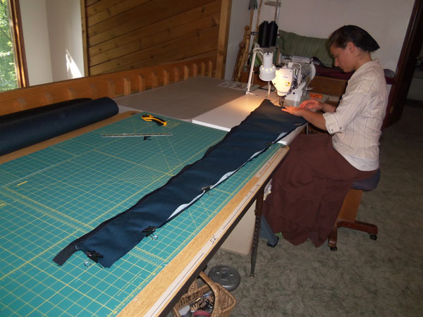 Emily sewing harp cases