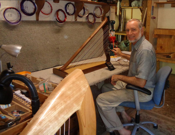 Alex stringing up a harp